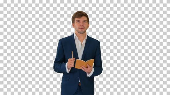 Young businessman thinking and writing, Alpha Channel