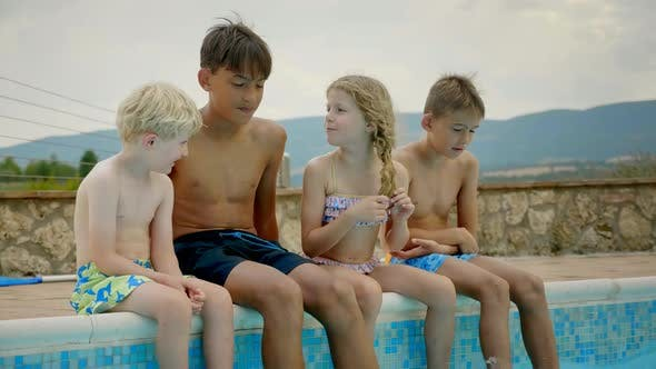 Thumbnail for Kids Cheerfully Talking By the Poolside
