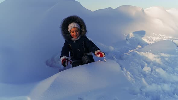 Thumbnail for Cheerful Child Playing in the Snow