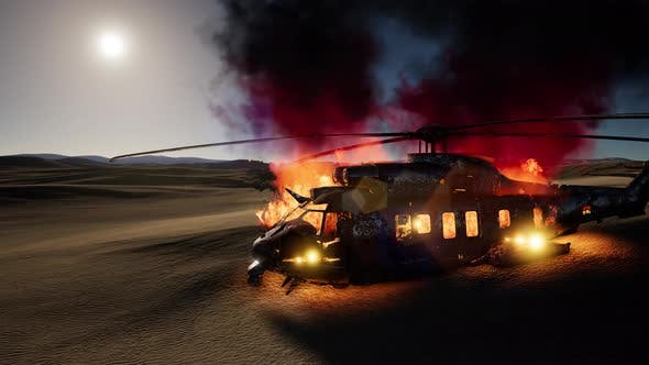 Thumbnail for Burned Military Helicopter in the Desert at Sunset