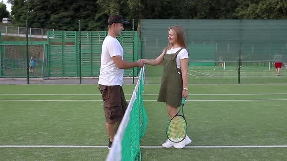 Thumbnail for The guy greets the girl before playing tennis