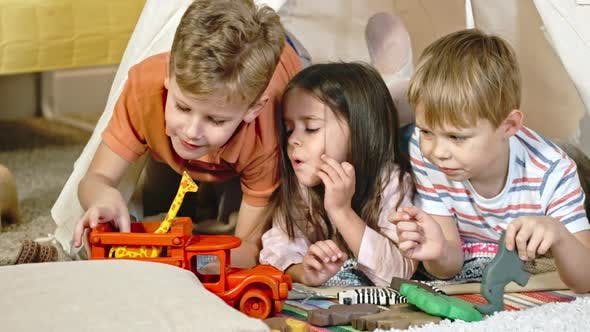 Little Boys and Girl Playing with Toys