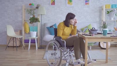 Young Woman with Disabilities in a Wheelchair Doing Make Up