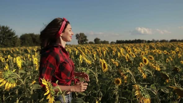 Thumbnail for Carefree Woman Running Through Field of Sunflowers