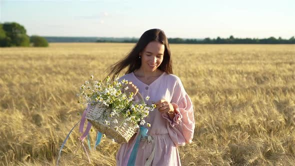 Thumbnail for Beautiful Girl in Wheat Field with Ripe Wheat in Hands