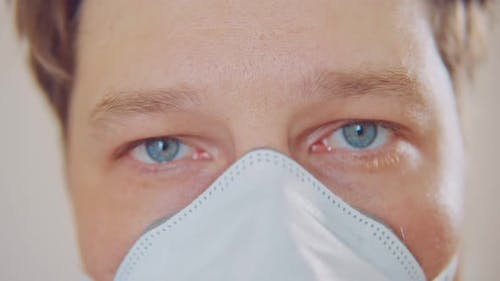 Face of a Man in a Respirator