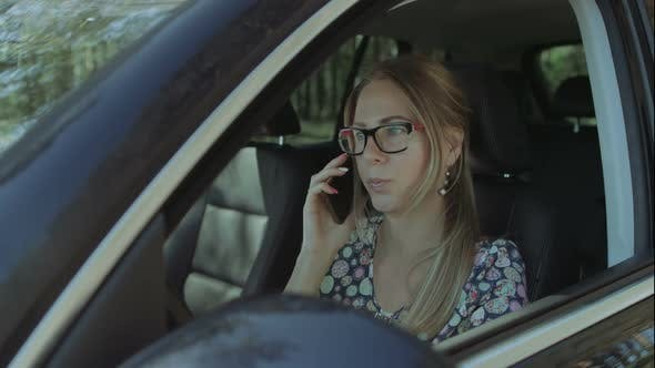 Thumbnail for Positive Woman Talking on Smart Phone in the Car