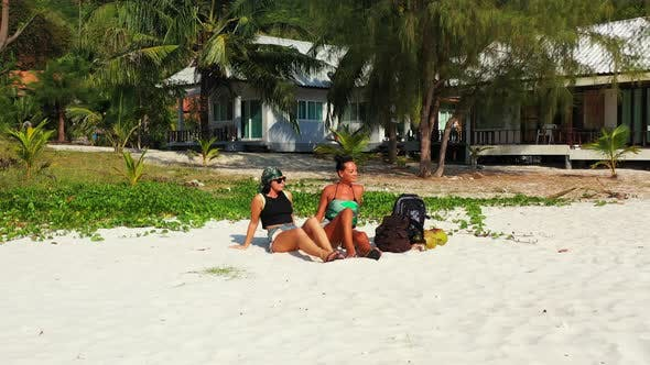 Thumbnail for Sexy smiling ladies relaxing enjoying life on beach on paradise white sand and blue background