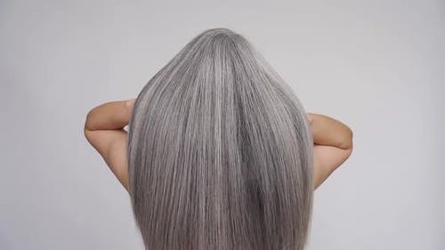 Senior Middle Aged Mature Woman Waving Grey Hair