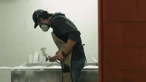 Thumbnail for Man in Respirator Mask Painting Wooden Planks at Workshop. Craftsman Modern Furniture Factory Paint