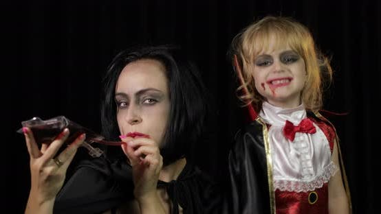 Thumbnail for Woman and Child Dracula. Halloween Vampire Make-up. Kid with Blood on Her Face