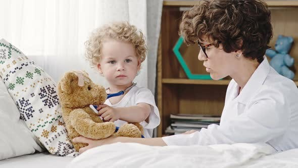 Cover Image for Toddler Playing Doctor with Plush Bear