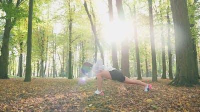 Happy Woman Doing Flexible Exercises Outdoors