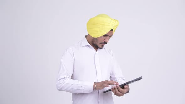 Thumbnail for Stressed Bearded Indian Sikh Businessman Using Digital Tablet and Getting Bad News