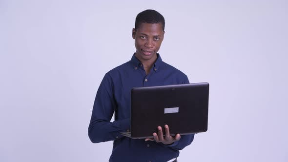 Thumbnail for Young Happy African Businessman Using Laptop