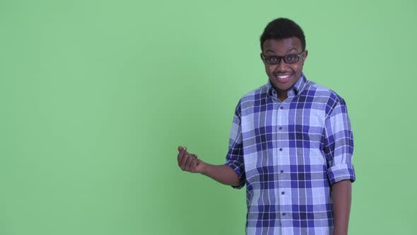 Thumbnail for Happy Young African Hipster Man Snapping Fingers and Showing Something