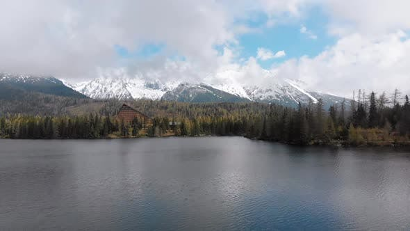 Thumbnail for Aerial View of Strbske Pleso, Slovakia. Mountain Lake in Clouds and Snowy Tatras Mountains