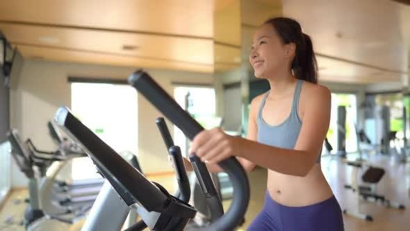 Woman run on treadmill in gym