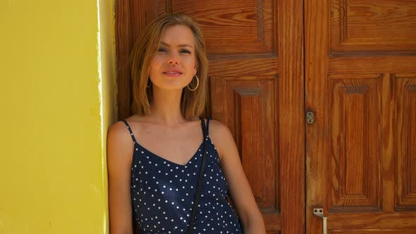 Thumbnail for Blonde Model Standing Against the Brown Door