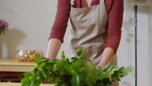 Cover Image for Flower shop employee processing fresh greenery