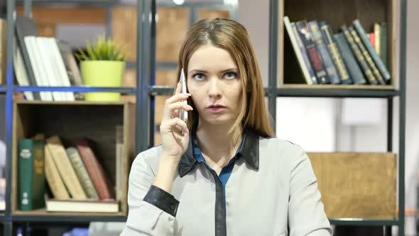 Thumbnail for Woman Talking On Smartphone, Indoor Office