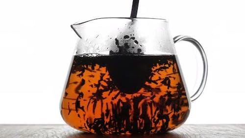 stir the tea in the teapot with a spoon. Process brewing tea, tea ceremony. 4K UHD video