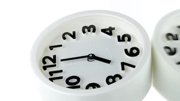 Vertical Video White Alarm Clock Showing Seven O'clock Spinning Rotating 360 Isolated on White