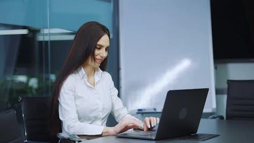 Businesswoman Reacting Emotionally To Good News