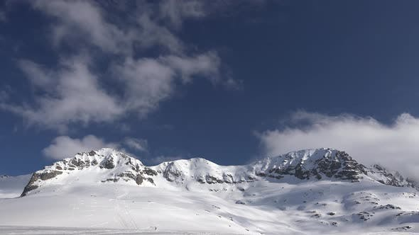 Thumbnail for High Altitude Rocky Snowy Mountain Ridge in Treeless Terrestrial Winter Climate