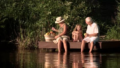 Old People and Grandchild with Picnic Basket.