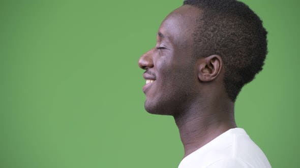 Thumbnail for Profile View of Young Happy African Man Relaxing with Eyes Closed