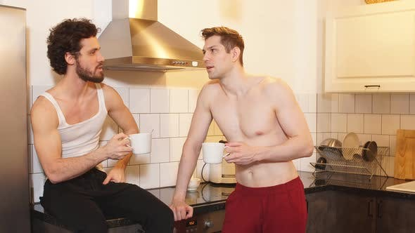 Handsome Gay Couple Drinking Coffee. Gay Relationships Concept.