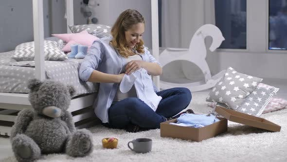 Thumbnail for Female Opening Delivery Package with Baby Clothes