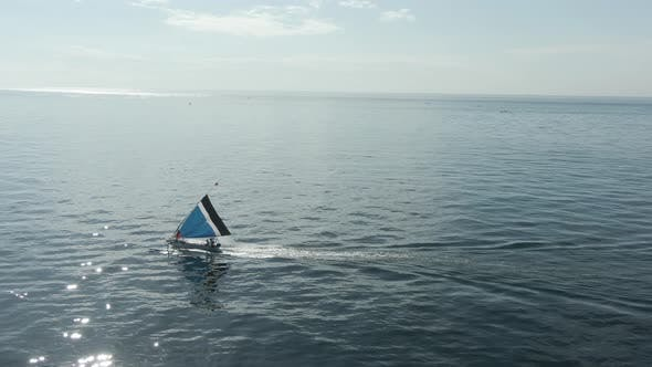 Aerial View Of Boat With Sail In Ocean In Bali, Indonesia. Terrific Seascape And Landscape