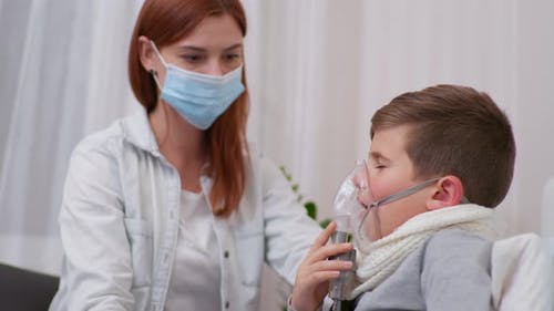 Woman Takes Care of Health of Male Child with Symptoms of Dangerous Illness and Helps Son To Inhale