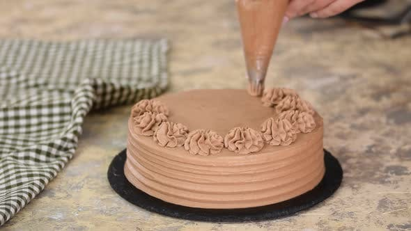 Thumbnail for Baker Decorated Chocolate Cake With Cream