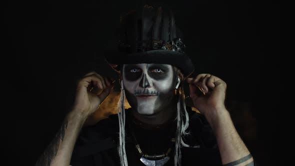 Sinister Man with Horrible Halloween Skeleton Makeup Puts on Headphones, Starts Dancing, Celebrating