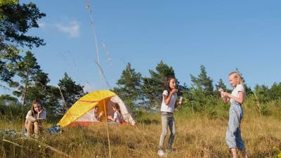 Happy children resting in nature in a tent. Nature. Forest. Fresh air.