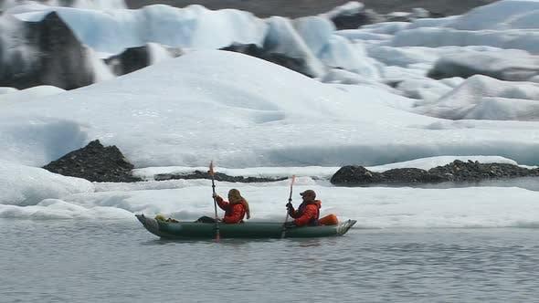 Thumbnail for Couple kayaking by icebergs and glacier, Alaska