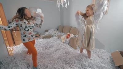Teen girls dancing at paper party