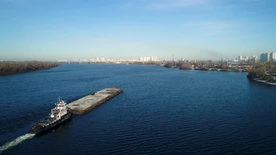 Thumbnail for Aerial View of the Barge with Sand Crossing River