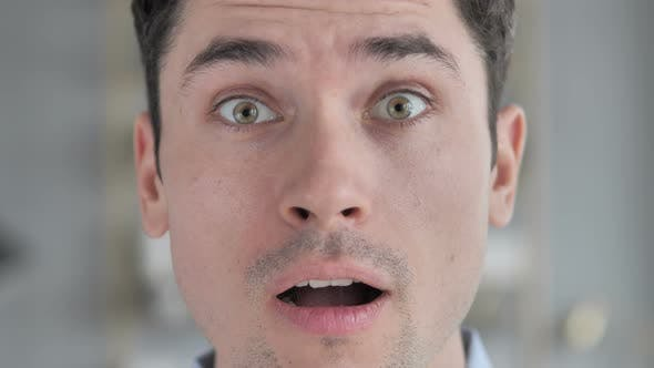 Face Close Up of Young Man in Shock, Wondering