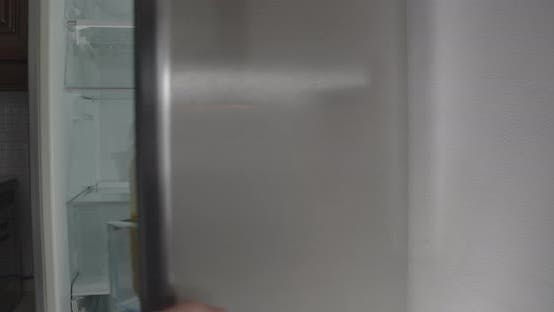 Thumbnail for Male Caucasian Hand Opening Grey Fridge, Taking Bun and Leaving