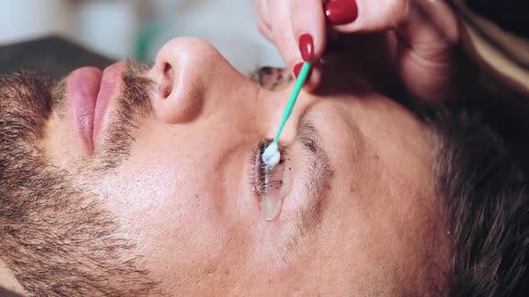 Thumbnail for Beautician Paints Eyelashes to a Client Male