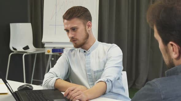 Thumbnail for Young Businessman Showing His Mature Colleague Something on the Laptop