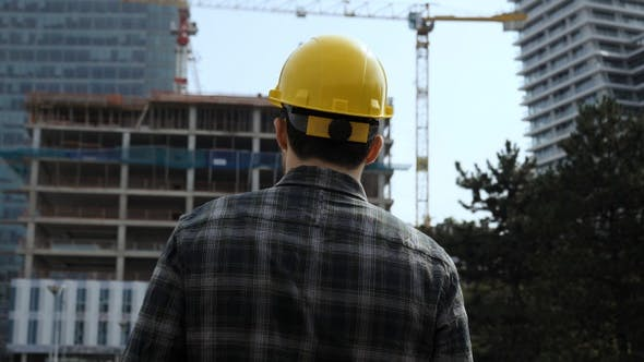 Thumbnail for Employee male warehouse worker engineer man in hard hat