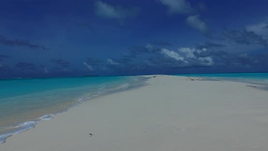 Thumbnail for Daytime flying island view of a paradise sunny white sand beach and blue water background in colourf
