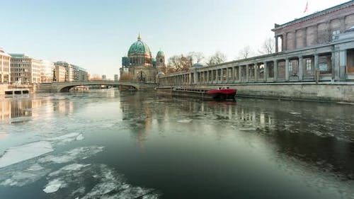 Time lapse of spree river and Berlin dome with ice floes
