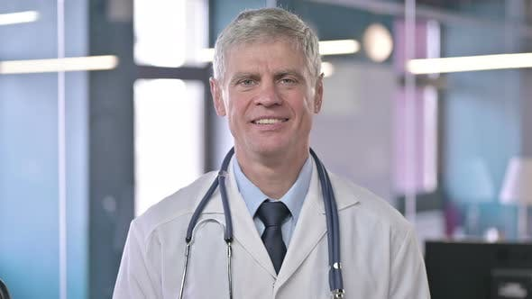 Thumbnail for Portrait of Cheerful Middle Aged Doctor Smiling at Camera