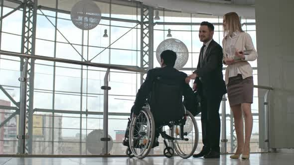 Thumbnail for Disabled Businessman Getting Support from Colleague